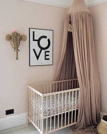 pink nursery idea with IKEA canopy over crib