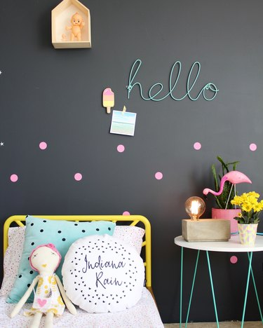kids bedroom idea with black walls and pops of neon color