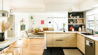 Kitchen that opens up into living room with bright natural light