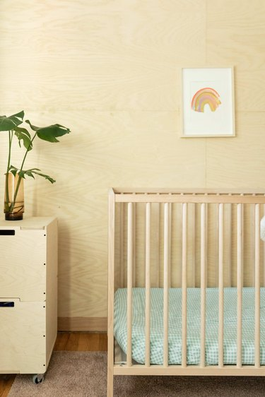 Plywood walls in the nursery.