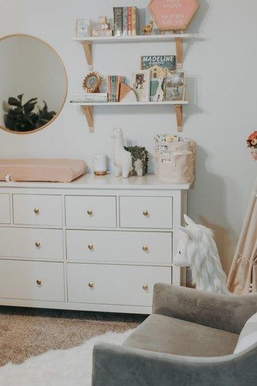 Nursery idea with IKEA dresser and shelving above