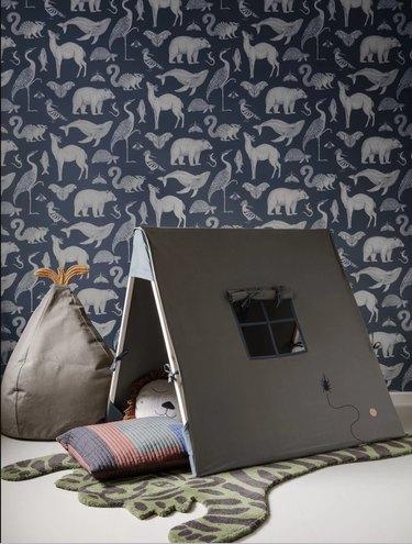 playroom decor with tiger rug and animal print wallpaper