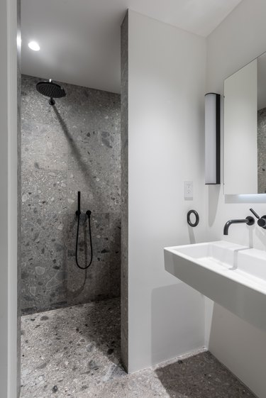 small bathroom with gray marble shower