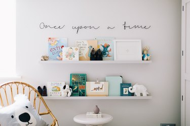 Nursery idea with IKEA shelving for books and accents