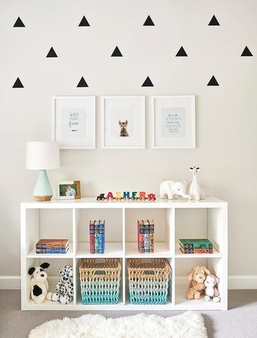 nursery idea with IKEA bookcase with toys and storage baskets
