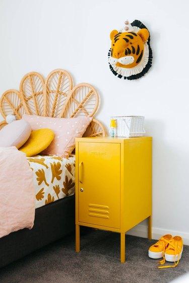 yellow kids room with cane headboard and yellow locker nightstand