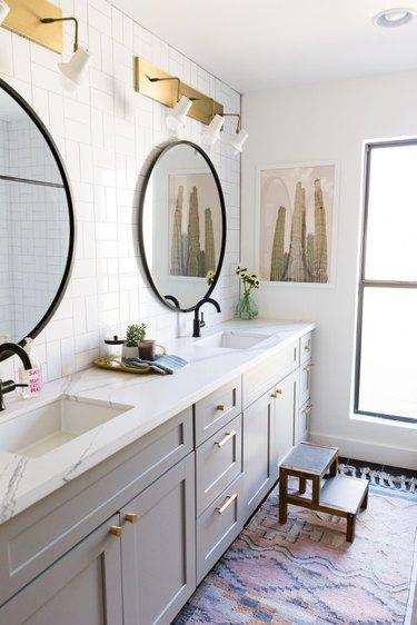 gray double vanity cabinet with brass door hardware