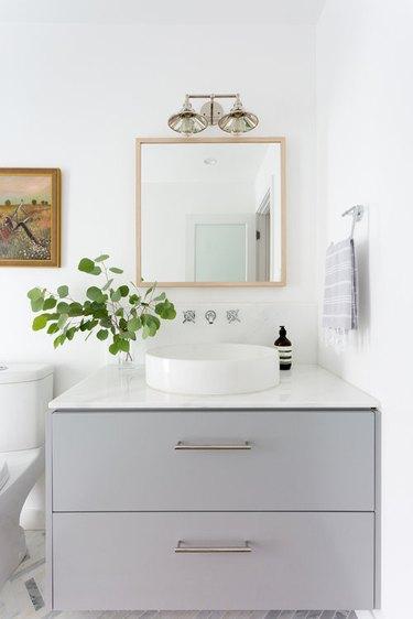 white bathroom with gray vanity cabinet