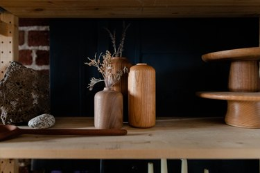 shelf with wooden vases and other wooden pieces