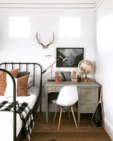 Kids' bedroom desk area featuring a color palette of gray, white, black, and rust