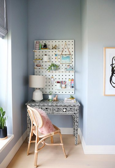 Kids' bedroom desk area in pink, blue, and white with bone inlay desk