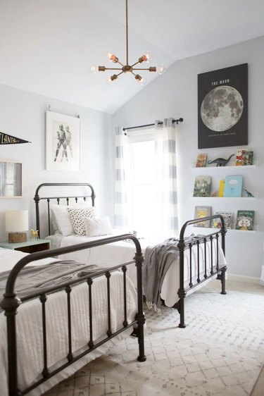 modern kids bedroom idea with traditional bed frames and chandelier hanging from ceiling