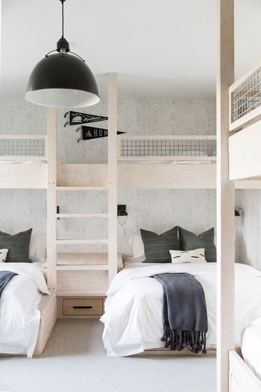 modern kids bedroom idea with neutral color palette and black industrial pendant lighting