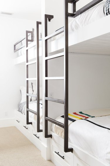 modern kids bedroom idea with black and white palette and bunk beds