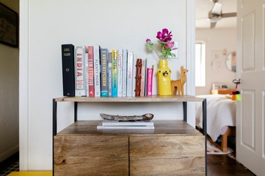 console with books and vase