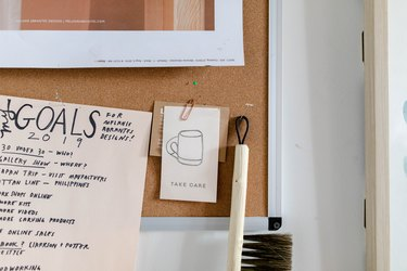 corkboard with papers and tools