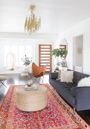 gray couch living room idea with patterned area rug on floor
