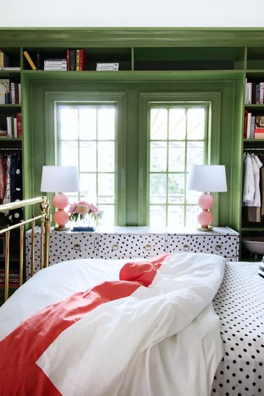 Green bedroom with built-in shelving