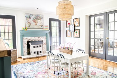 kids' playroom decor with large Persian rug below table and chairs