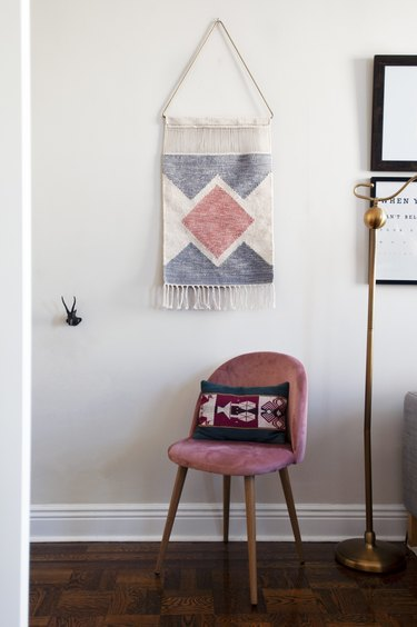 Wall art above pink chair