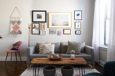 Couch in living room with wall art