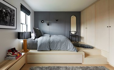 teen bedroom idea with platform bed with built-in storage and upholstered wall panels