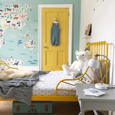 boys bedroom idea with blue map mural and yellow door to match bed