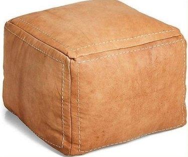 Square tan leather pouf