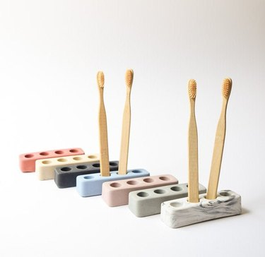 7 minimal concrete toothbrush holders with four holes in pale hues