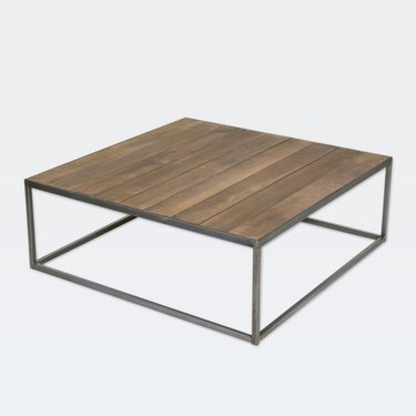Square minimal coffee table with black metal base and dark wood top