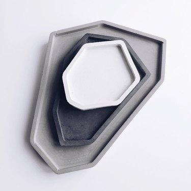 Gray, black, and white concrete nesting trays in geometric shapes