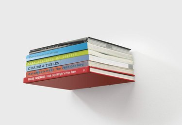Stack of books on invisible floating shelf