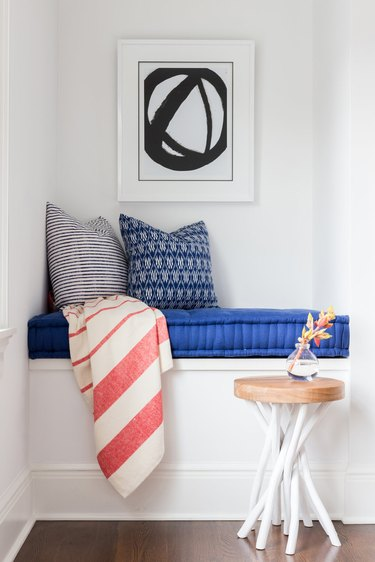 teen bedroom idea with reading nook complete with cushion, pillows, and blanket