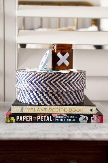 Storage basket set upon books