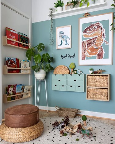 Jurassic themed boys bedroom idea with blue walls and potted plants