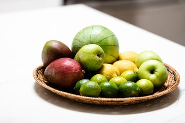 Produce in basket on kitchen counter