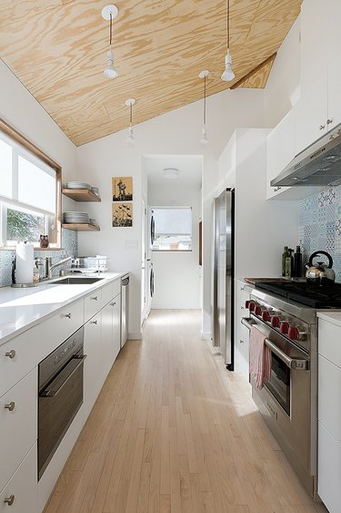 white galley kitchen with angled ceiling
