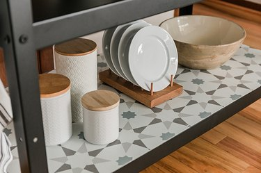 Cover the bottom shelf with peel-and-stick tiles.