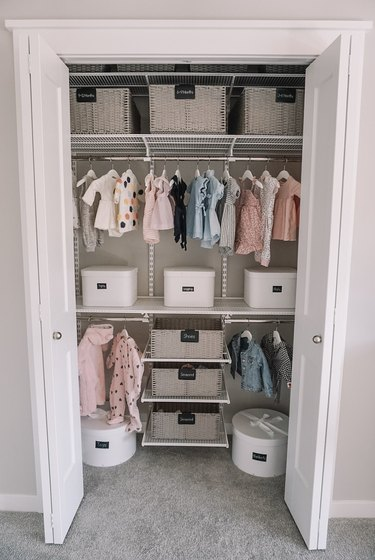 nursery organization in closet with bins and and shelving