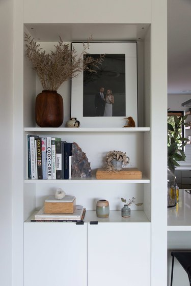 Living room nook with decor accessories and dried plant