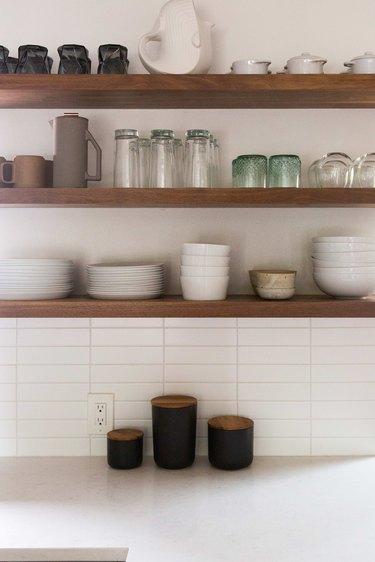 Open shelves over quartz countertop.