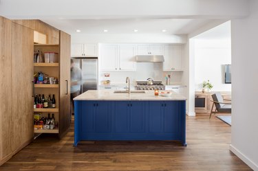 kitchen with white and blue cabinetry