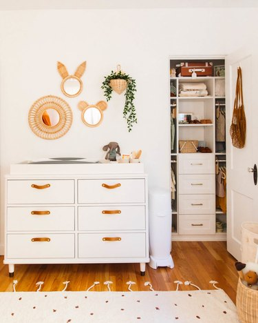 Small closet nursery organization with drawers and shelving