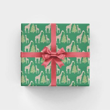 RevelAndCo Giraffes Trimming Trees Wrapping Paper (3 sheets), $15