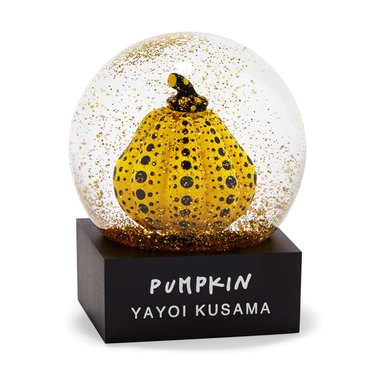 glitter snow globe with yellow pumpkin inside