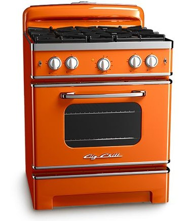 Tangerine-colored retro stove with chrome accents