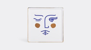 ceramic tray with face illustration