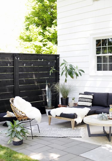 Black and white small patio ideas with throw pillows, rugs, and faux fur