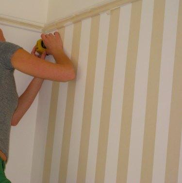 Preparing to paint stripes.