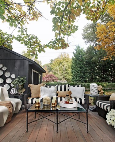 Outdoor living room small patio ideas with vintage-inspired decor and black and white furniture
